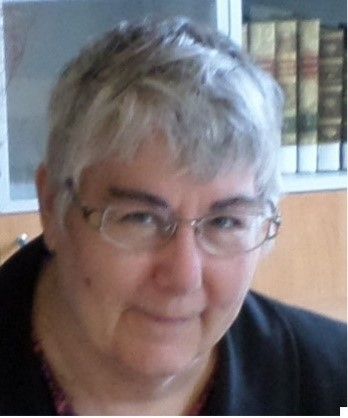 image of a lady in glasses with short grey hair