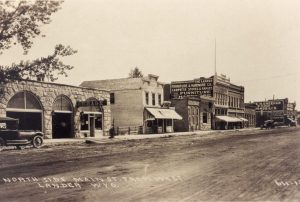 black and white historic image of several buildings on Main Street in Lander, WY.